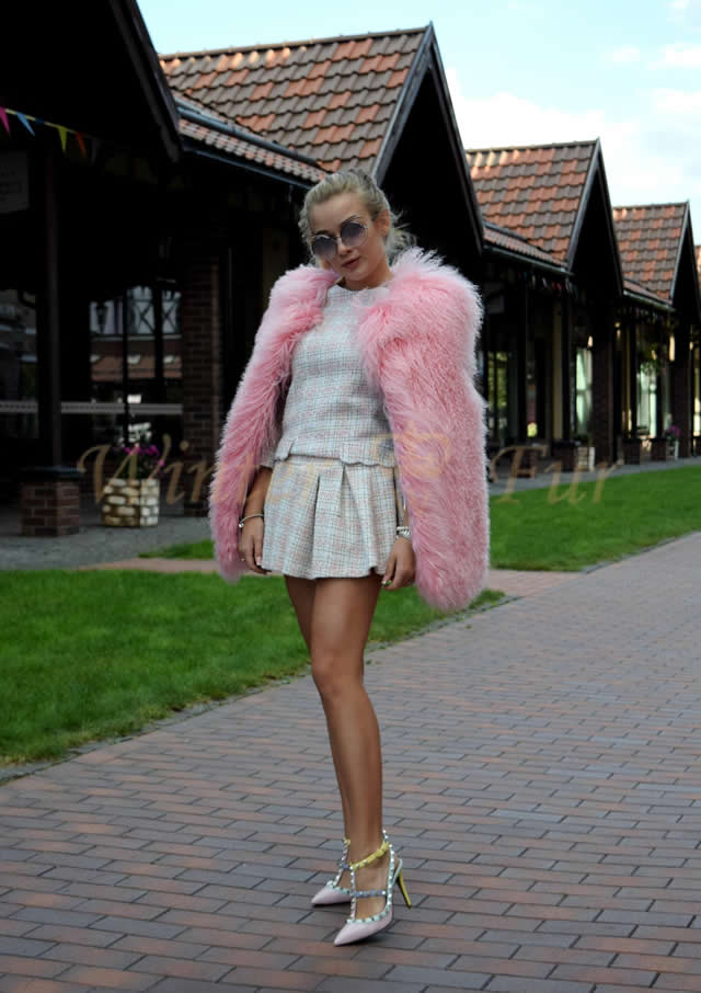 Розовая меховая жилетка из ламы